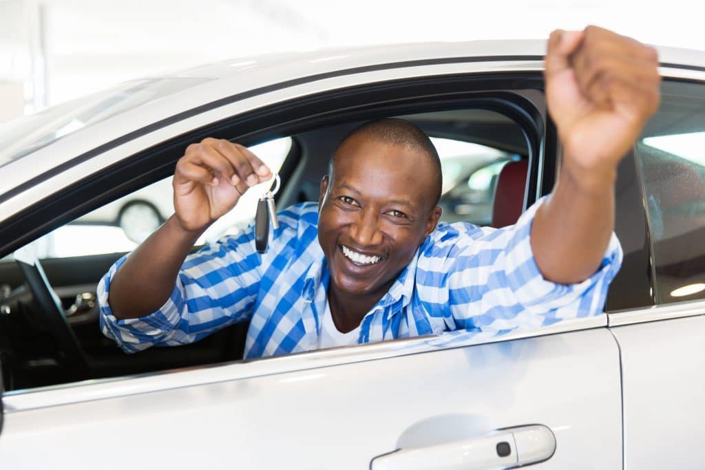 Winnipeg man in a car happy about getting 0% financing on his car loan